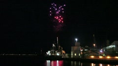 Fireworks over water, cargo ship in foreground  quayside Stock Footage