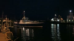 Small passenger  boat leaves the quay for a night time sail 6712 2 Stock Footage
