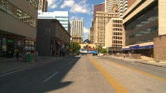 Drive plate, summer afternoon city, #31 stopped in lane, downtown Stock Footage