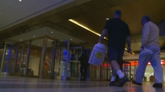 Commutors going through swing doors (Central Station) Stock Footage