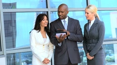 Multi Ethnic Business Team Using Wireless Tablet Stock Footage