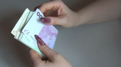 A business woman counting Euro for a transaction Stock Footage