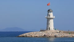 Ship and white lighthouse Stock Footage