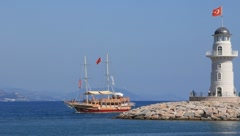 Ship and white lighthouse - stock footage