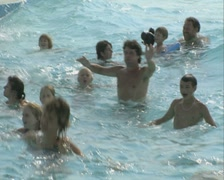 People in a wave pool Stock Footage