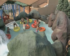 People on inflatable rings at a water park Stock Footage