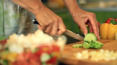 Female hands slicing cucumber, dolly shot HD Stock Footage