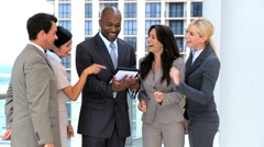 Business Team Get Good News from Wireless Tablet - stock footage