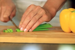 Female hands slicing chive, dolly shot NTSC Stock Footage