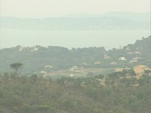 Zoom out and pan to reveal golf course in the hills Stock Footage