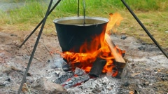 Kettle over campfire Stock Footage