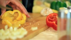 Stock Video Footage of Female hands slicing yellow pepper, dolly shot HD