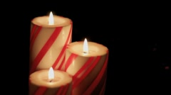 Trio of striped christmas candles Stock Footage