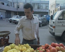 Street vendor selling apples Stock Footage