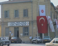 Turkish and Turkish Cypriot Flags on a building Stock Footage