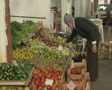 Nicosia Old man moves produce on a market stall SD Footage