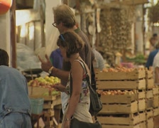 Shoppers in a market in Nicosia Stock Footage