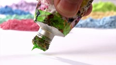 Think green. Concept Studio shot. Green oil paint and paintbrush, timelapse. - stock footage