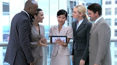 Ambitious Business Executives Using Wireless Tablet Stock Footage