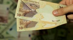 Currency Exchange Rates, Foreign Money Converter, Qatari Riyal QAR Stock Footage