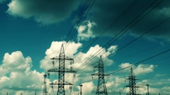 Stock Video Footage of electric high voltage pylon against sky, time lapse