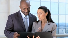 Multi Ethnic Business Executives with Work Portfolios Stock Footage
