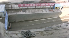Construction truck coming out of mine in China Stock Footage