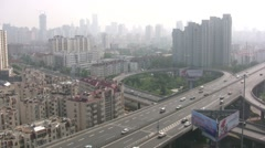 China traffic drives over flyover in Qingdao city covered in smog Stock Footage