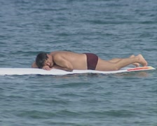 Man sleeping on a surfboard Stock Footage