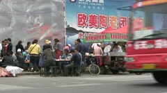 China factory workers, lunch break, food stall, roadside, Chinese Stock Footage