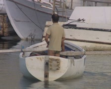 Two men in a white rowboat - stock footage