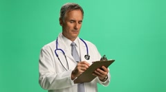 Doctor w pad - medium Stock Footage