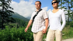Young happy couple walking on trip HD Stock Footage