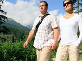 Stock Video Footage of Young happy couple walking on trip NTSC