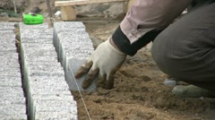 Laying bricks in Chinese city, migrant worker, labor, poverty, inequality Stock Footage