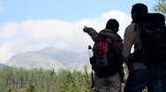 Silhouette of couple on a trip looking at the mountain HD Stock Footage