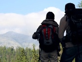 Stock Video Footage of Silhouette of couple on a trip looking at the mountain NTSC