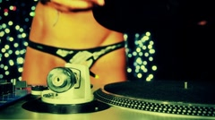 Super sexy female dj playing records Stock Footage
