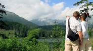 Stock Video Footage of Couple on a trip looking at the mountain in the clouds, dolly shot HD