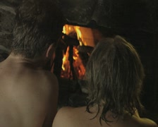 A group of people cooking food on a fire after a sauna Stock Footage