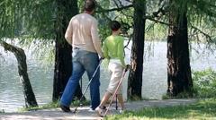 Couple nordic walking by the lake HD Stock Footage