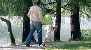 Stock Video Footage of Couple nordic walking by the lake HD