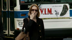 Lady yawns before crossing road Stock Footage