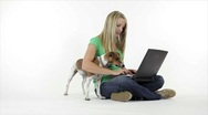 Stock Video Footage of Pretty girl and her dog with laptop