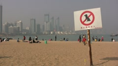 No dogs allowed on the beach - China Stock Footage
