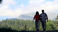 Stock Video Footage of Couple walking, hiking in the mountains HD