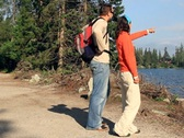 Stock Video Footage of Couple on a trip by the beautiful lake in the woods NTSC