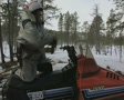 Snowmobile pulling a sled heads off into the forest SD Footage