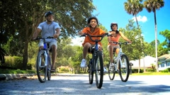 Healthy African American Family Cycling Together Stock Footage