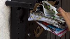 squeezing mail into postbox - stock footage